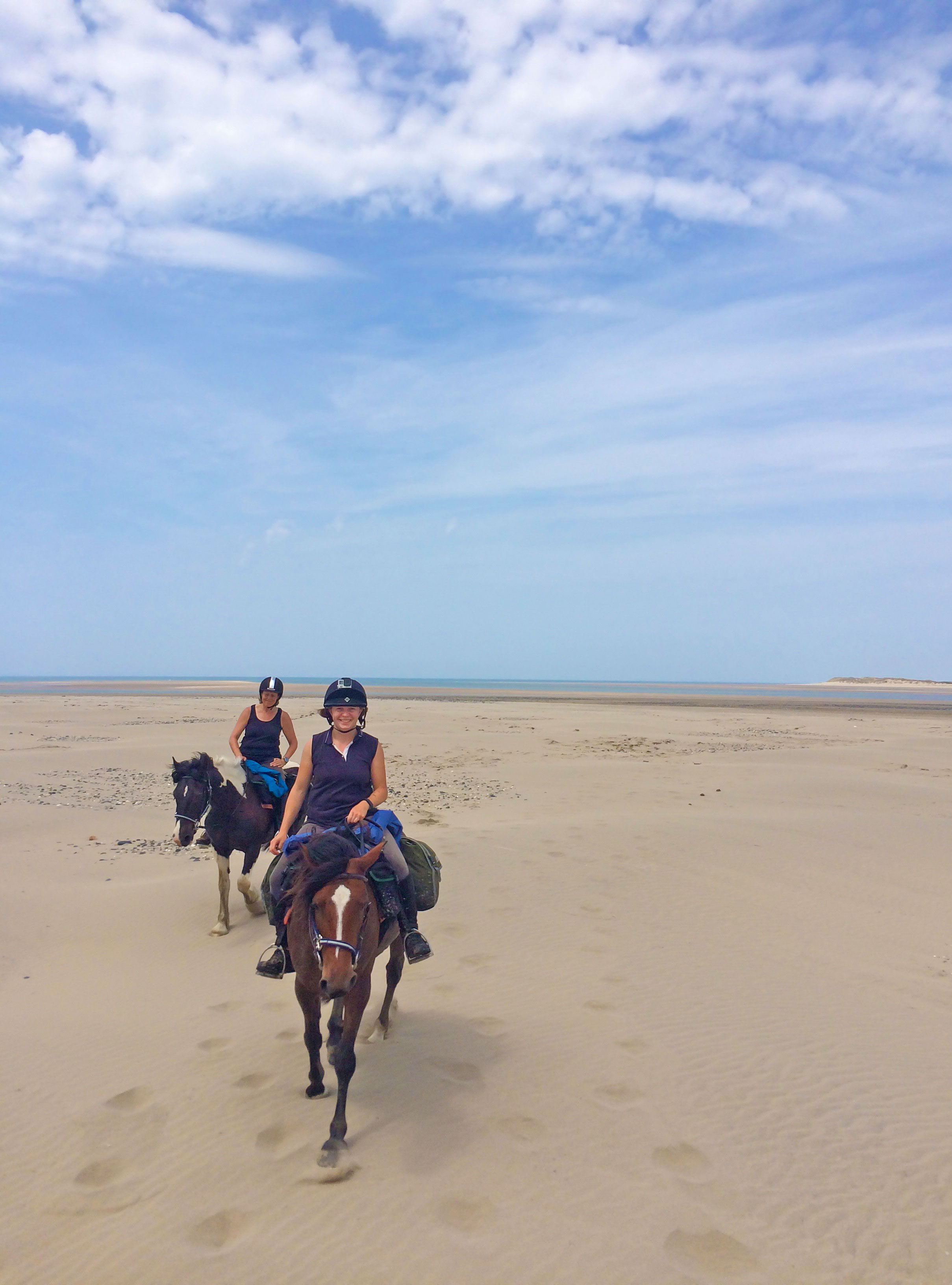 Horses and Riders enjoying the beach at Ynyslas